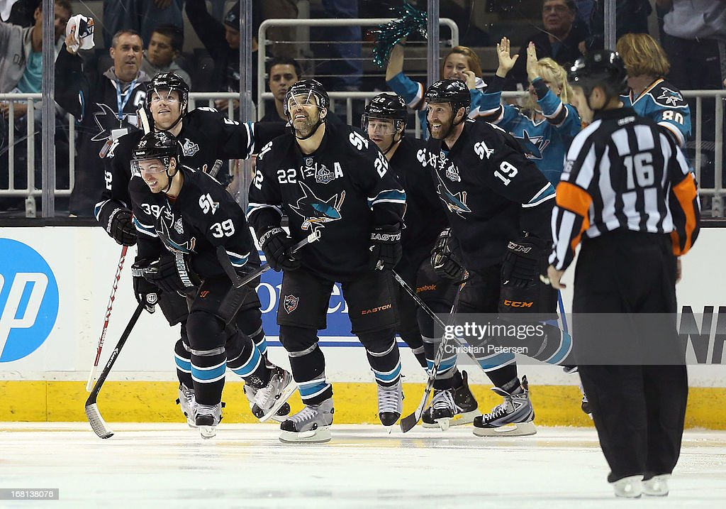 Matt Irwin #52, Logan Couture #39, Dan Boyle #22, Patrick Marleau #12 and Joe Thornton #19 of the San Jose Sharks celebrate after Couture scored a third period goal against the Vancouver Canucks in Game Three of the Western Conference Quarterfinals during the 2013 NHL Stanley Cup Playoffs at HP Pavilion on May 5, 2013 in San Jose, California. The Sharks defeated the Canucks 5-2.