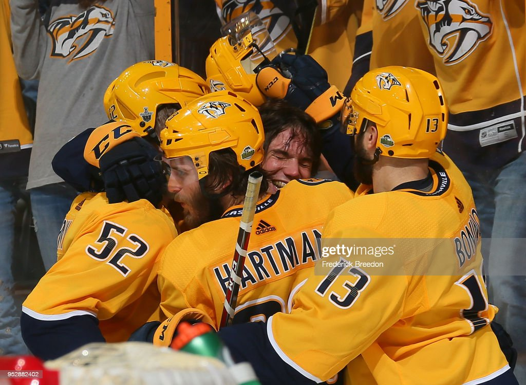 Matt Irwin #52, Ryan Hartman #38, and Nick Bonino #13 congratulate teammate Kevin Fiala #22 on scoring the game winning goal in the second period of overtime in a 5-4 Predators victory in Game Two of the Western Conference Second Round during the 2018 NHL Stanley Cup Playoffs at Bridgestone Arena on April 29, 2018 in Nashville, Tennessee.