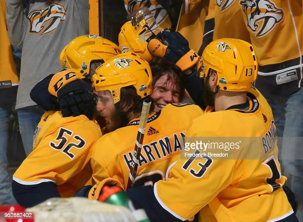 Matt Irwin Ryan Hartman and Nick Bonino congratulate teammate Kevin Fiala on scoring the game winning goal in the second period of overtime in a 54...