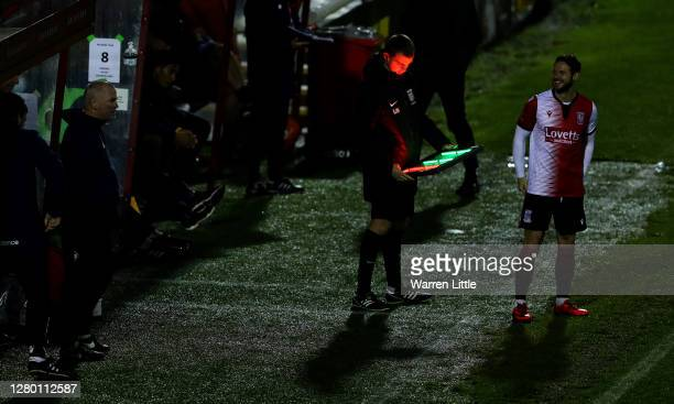 Matt Jarvis of Woking FC awaits for the assistant referee makes changes to the board to enter the field as a substitute during the Vanarama National...
