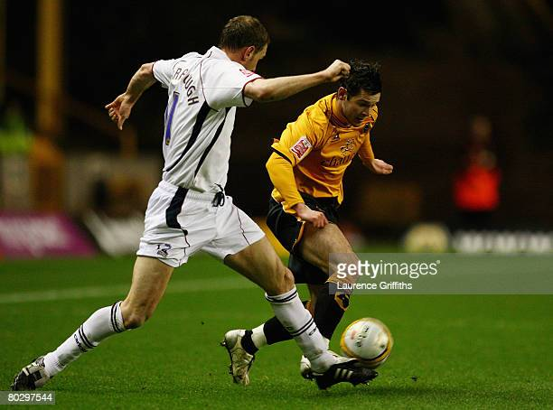 Matt Jarvis of Wolves battles with Ian Baraclough of Scunthorpe during the Coca Cola Championship match between Wolverhampton Wanderers and...