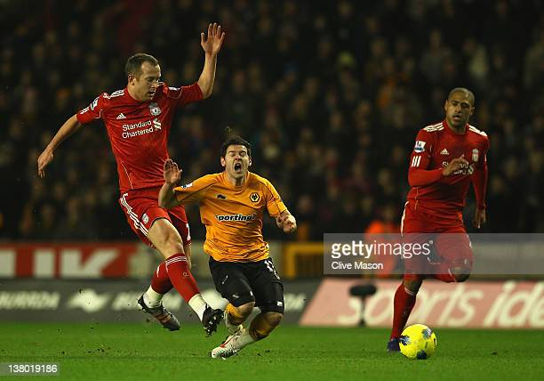 Matt Jarvis of Wolves is tackled by Charlie Adam of Liverpool during the Barclays Premier League match between Wolverhampton Wanderers and Liverpool...