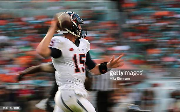 Matt Johns of the Virginia Cavaliers passes during a game against the Miami Hurricanes at Sun Life Stadium on November 7 2015 in Miami Gardens Florida