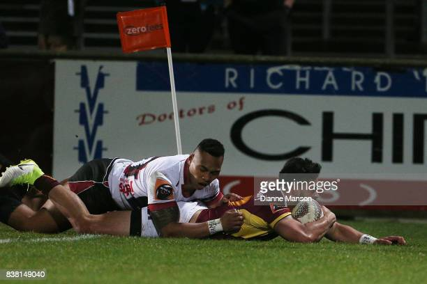 Matt Johnson of Southland dives over to score a try while in the tackle of Tevita Li of North Harbour during the Mitre 10 Cup match between Southland...