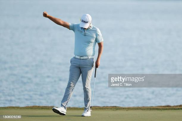 Matt Jones of Australia celebrates on the 18th green after winning during the final round of The Honda Classic at PGA National Champion course on...