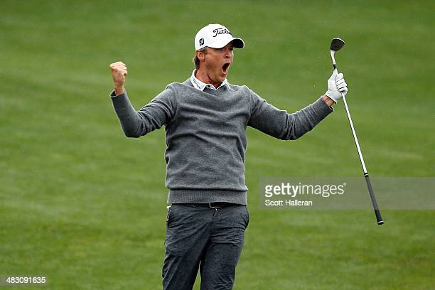 Matt Jones of Australia celebrates on the fairway after hitting the hole for birdie on the eighteenth hole during the final round of the Shell...
