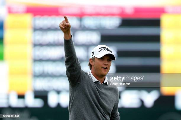 Matt Jones of Australia celebrates on the green after putting for birdie on the eighteenth hole during the final round of the Shell Houston Open at...