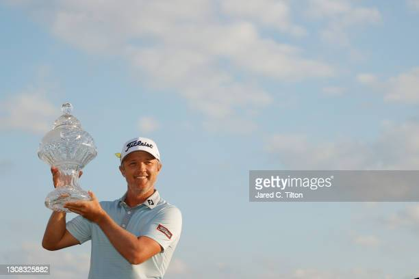 Matt Jones of Australia celebrates with the trophy after winning during the final round of The Honda Classic at PGA National Champion course on March...