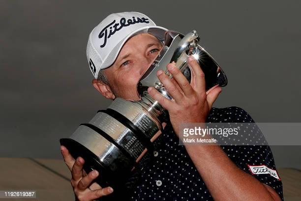 Matt Jones of Australia kisses the Stonehaven Cup after winning the 2019 Australian Open during day four of the 2019 Australian Golf Open at The...