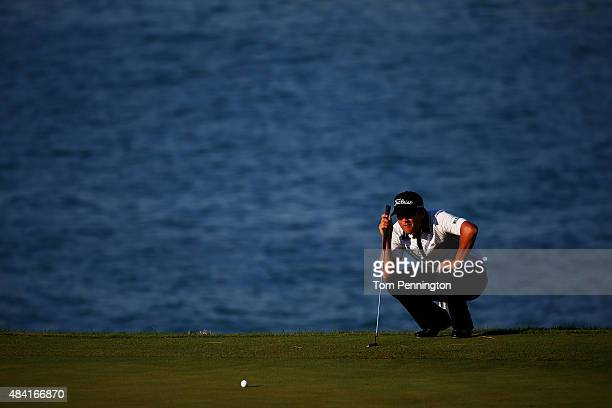 Matt Jones of Australia lines up a putt on the 13th green during the third round of the 2015 PGA Championship at Whistling Straits on August 15 2015...