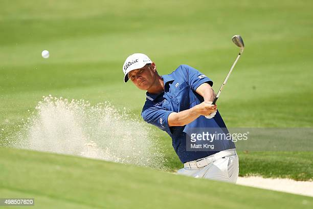 Matt Jones of Australia plays a bunker shot on the 8th hole during a practice round ahead of the 2015 Australian Open at The Australian Golf Course...