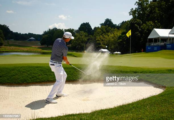 Matt Jones of Australia plays a shot from a greenside bunker on the 15th hole during the first round of the Wyndham Championship at Sedgefield...