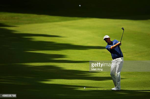 Matt Jones of Australia plays an approach shot on the 5th hole during a practice round ahead of the 2015 Australian Open at The Australian Golf...