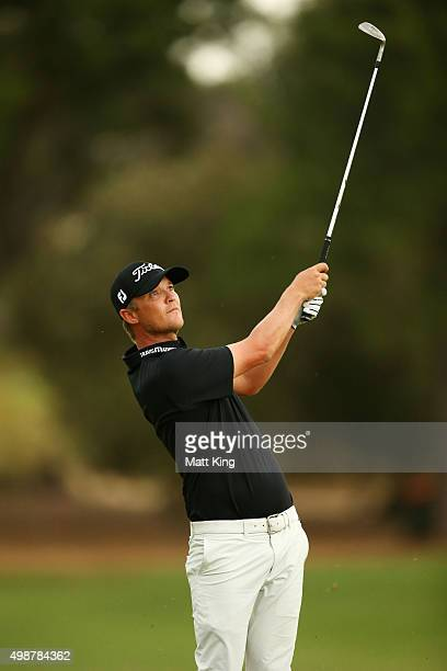 Matt Jones of Australia plays his approach shot on the 18th hole during day one of the 2015 Australian Open at The Australian Golf Club on November...