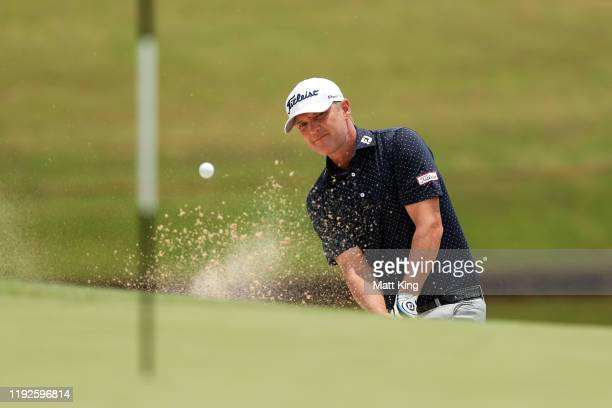 Matt Jones of Australia plays out of the bunker on the 4th hole during day four of the 2019 Australian Golf Open at The Australian Golf Club on...
