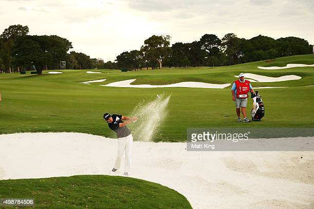 Matt Jones of Australia plays out of the fairway bunker on the 18th hole during day one of the 2015 Australian Open at The Australian Golf Club on...