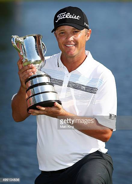 Matt Jones of Australia poses with the Stonehaven trophy after winning the 2015 Australian Open during day four of the Australian Open at The...
