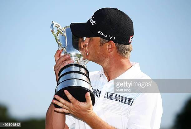 Matt Jones of Australia poses with the Stonehaven trophy after winning the 2015 Australian Open during day four of the Australian Open at The...