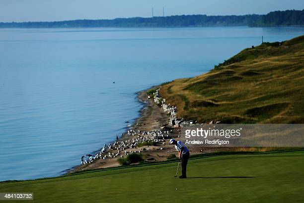 Matt Jones of Australia putts on the eighth green during the continuation of the weather-delayed second round of the 2015 PGA Championship at...