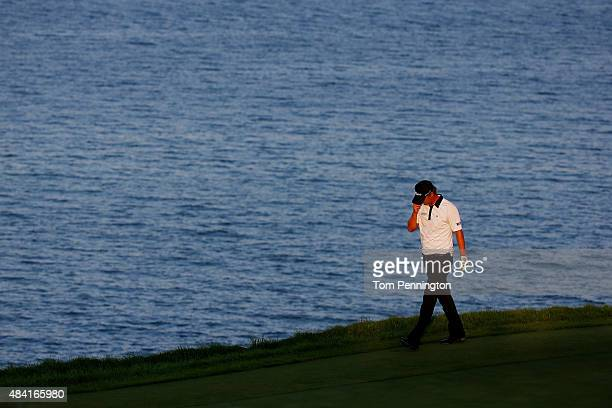 Matt Jones of Australia reacts after his shot on the 17th green during the third round of the 2015 PGA Championship at Whistling Straits at on August...