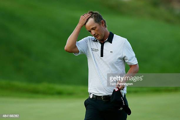 Matt Jones of Australia walks off the 18th green during the third round of the 2015 PGA Championship at Whistling Straits at on August 15, 2015 in...