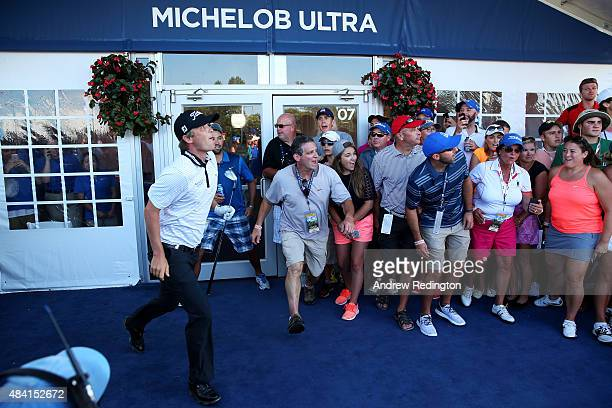 Matt Jones of Australia watches his second shot from the carpet of a hospitality tent during the third round of the 2015 PGA Championship at...