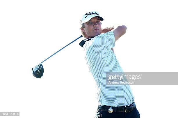 Matt Jones of Australia watches his tee shot on the ninth hole during the continuation of the weather-delayed second round of the 2015 PGA...