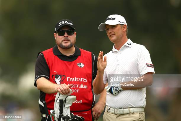 Matt Jones of New South Wales talks to his caddie on the 5th hole during day two of the 2019 Australian Golf Open at The Australian Golf Club on...