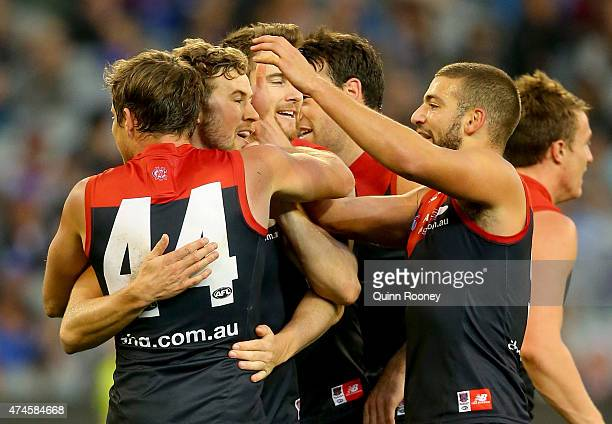 Matt Jones of the Demons is congratulated by team mates after kicking a goal during the round eight AFL match between the Melbourne Demons and the...