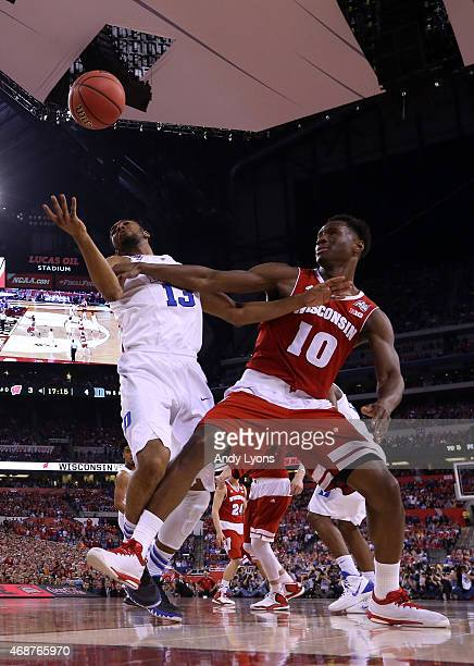 Matt Jones of the Duke Blue Devils and Nigel Hayes of the Wisconsin Badgers go for a loose ball in the first half during the NCAA Men's Final Four...