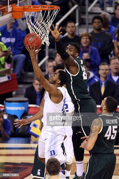 Matt Jones of the Duke Blue Devils drives to the basekt against Branden Dawson of the Michigan State Spartans in the second half during the NCAA...