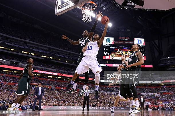 Matt Jones of the Duke Blue Devils drives to the basket against Branden Dawson of the Michigan State Spartans in the second half during the NCAA...