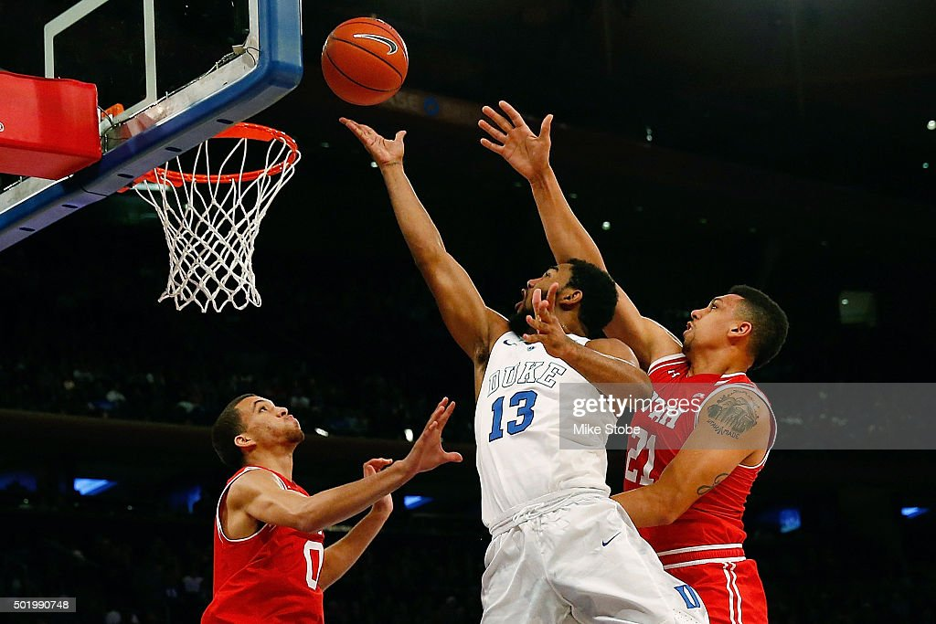 Matt Jones #13 of the Duke Blue Devils drives to the basket against Jordan Loveridge #21 of the Utah Utes during the Ameritas Insurance Classic at Madison Square Garden on December 19, 2015 in New York City.