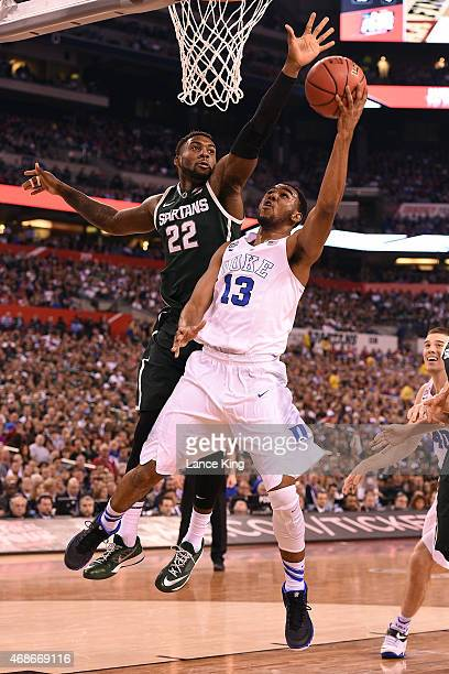 Matt Jones of the Duke Blue Devils goes to the basket against Branden Dawson of the Michigan State Spartans during the NCAA Men's Final Four...