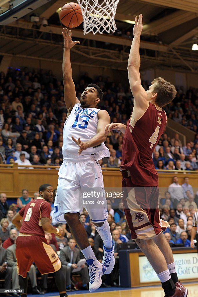 Matt Jones #13 of the Duke Blue Devils goes to the basket against Eddie Odio #4 of the Boston College Eagles during their game at Cameron Indoor Stadium on January 3, 2015 in Durham, North Carolina.