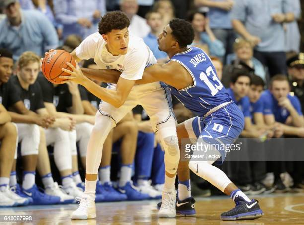 Matt Jones of the Duke Blue Devils tries to steal the ball from Justin Jackson of the North Carolina Tar Heels during their game at the Dean Smith...