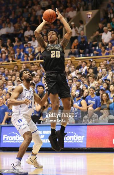 Matt Jones of the Duke Blue Devils watches as John Collins of the Wake Forest Demon Deacons shoots the ball during their game at Cameron Indoor...