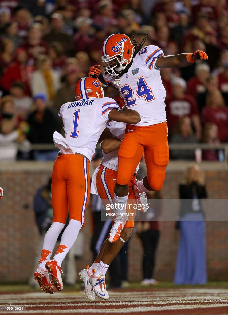 Matt Jones #24 of the Florida Gators celebrates a touchdown with Quinton Dunbar #1 during a game against the Florida State Seminoles at Doak Campbell Stadium on November 24, 2012 in Tallahassee, Florida.