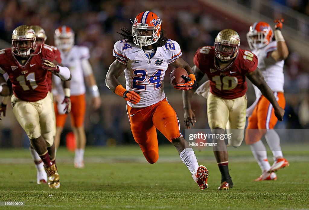 Matt Jones #24 of the Florida Gators rushes for a touchdown during a game against the Florida State Seminoles at Doak Campbell Stadium on November 24, 2012 in Tallahassee, Florida.
