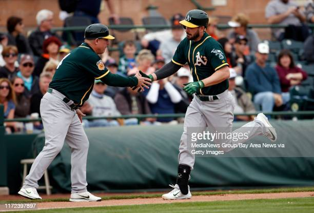 Matt Joyce hits a 1st inning home run for the Oakland Athletics off San Francisco Giants pitcher Jeff Samardzija during a game Monday Feb 27 at...