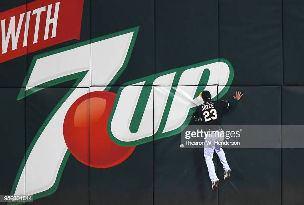 Matt Joyce of the Oakland Athletics collides with the left centerfield wall going after this ball that goes for a tworun RBI double off the bat of...