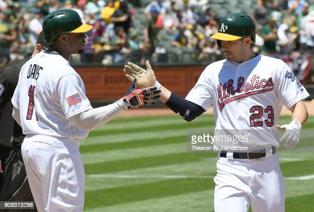 Matt Joyce of the Oakland Athletics is congratulated by Rajai Davis after Joyce hit a tworun homer against the Chicago White Sox in the bottom of the...