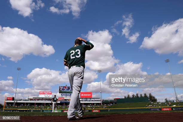 Matt Joyce of the Oakland Athletics walks out onto the field during the third inning of the spring training game against the Chicago Cubs at Sloan...