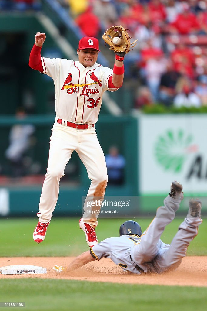 Matt Joyce #17 of the Pittsburgh Pirates advances to second base against Aledmys Diaz #36 of the St. Louis Cardinals at Busch Stadium on October 1, 2016 in St. Louis, Missouri.