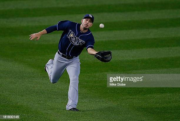 Matt Joyce of the Tampa Bay Rays catches a fly ball off the bat of Mark Reynolds of the New York Yankees in the fourth inning at Yankee Stadium on...