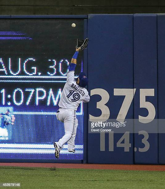 Matt Joyce of the Tampa Bay Rays drives a ball just out of the reach of Jose Bautista of the Toronto Blue Jays in the top of the 5th inning during...