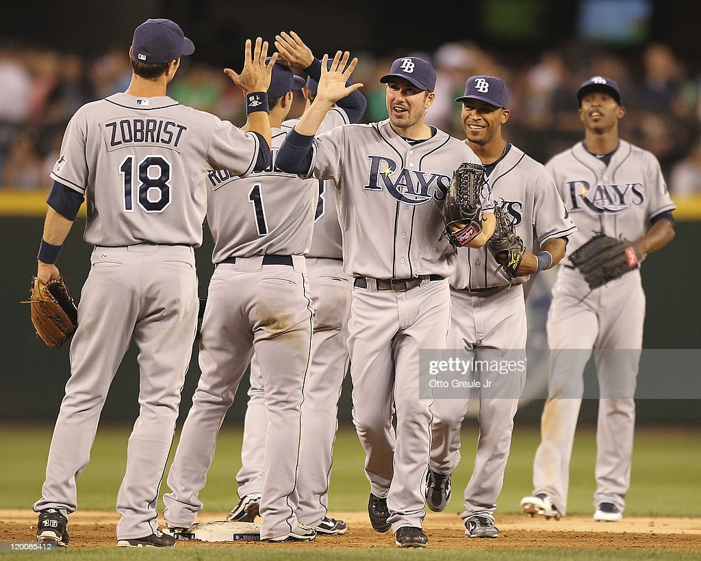 Matt Joyce #20 of the Tampa Bay Rays is congratulated by Ben Zobrist #18 after defeating the Seattle Mariners 8-0 at Safeco Field on July 29, 2011 in Seattle, Washington.
