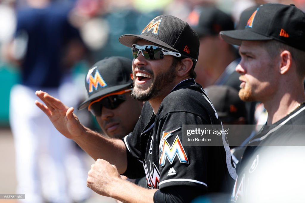 Matt Juengel #88 of the Miami Marlins shares a laugh with teammates in the dugout during a Grapefruit League spring training game against the Atlanta Braves at Champion Stadium on March 20, 2017 in Lake Buena Vista, Florida. The Marlins defeated the Braves 9-3.