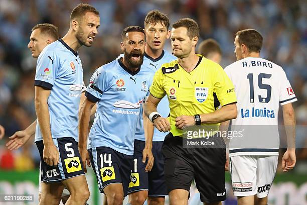 Matt Juryman Alex Brusque and Filip Holosko of Sydney FC make their point to the referee Chris Beath during the round five ALeague match between...