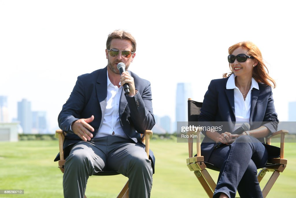 Matt Kamienski, Presidents Cup tournament director (L), and Joelle Grunberg, LACOSTE CEO attend LACOSTE 'Official Apparel Provider' unveiling during 2017 Presidents Cup Media Day at Liberty National Golf Club on August 21, 2017 in Jersey City, NJ.